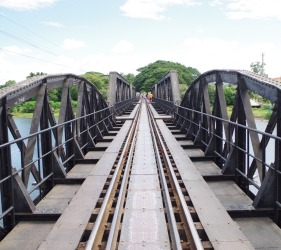 Save Money While Travelling - Walking over The Bridge over The River Kwai in Kanchanburi